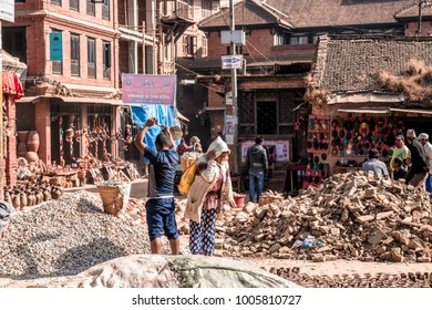 Bhaktapur, Nepal - December 16, 2017. People in the streets of Bhaktapur is working with the construction.