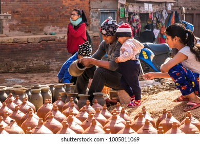 Bhaktapur, Nepal - December 16, 2017. People in square of Bhaktapur is working with pottery.