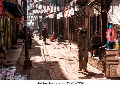 Bhaktapur, Nepal - December 16, 2017. People in square of Bhaktapur is working.