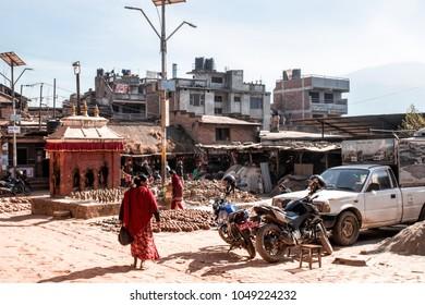 Bhaktapur, Nepal - December 16, 2017. People in square of Bhaktapur is walking on the street.