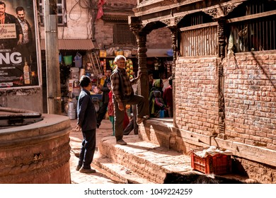 Bhaktapur, Nepal - December 16, 2017.  Unknown Nepali peopal are standing outside the building and talking together.