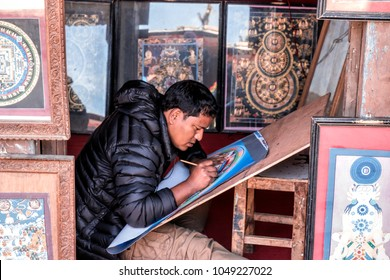 Bhaktapur, Nepal - December 16, 2017. An Unknown Nepali man is drawing the Mandala.