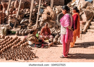 Bhaktapur, Nepal - December 16, 2017. People in square of Bhaktapur is selling the pottery.