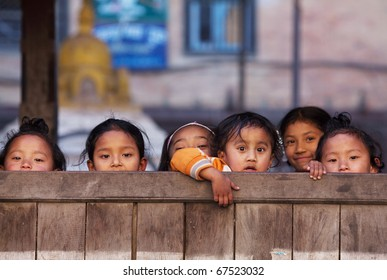 BHAKTAPUR, NEPAL - JANUARY 08: Group of Nepalese schoolgirl - outdoor games on the street of old town on January 08, 2010 in Bhaktapur, Kathmandu Valley, Nepal.