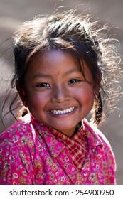 BHAKTAPUR, NEPAL - JANUARY 08: Nevaris schoolgirl Lakshmi, 8, poses for a photo during her breaktime on January 08, 2010 in Bhaktapur, Kathmandu Valley, Nepal.