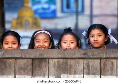 BHAKTAPUR, NEPAL - JANUARY 8: Nepalese schoolgirls pose for a photo during their break time on January 8, 2010 in Bhaktapur, Kathmandu Valley, Nepal.