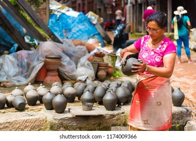 Bhaktapur, Nepal - July 16, 2018 : Traditional pottery in Bhatktapur city, famous for the best-preserved palace courtyards and old city center in Nepal, is also a UNESCO World Heritage Site