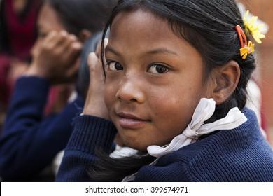BHAKTAPUR, NEPAL - NOVEMBER 1, 2013: An undefined nepalese school girle portrayed in NEPAL