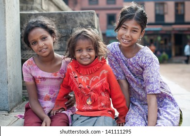 BHAKTAPUR, NEPAL - SEP 29 : Unidentified smiling girls on September 29, 2012 in Bhaktapur, Nepal. Bhaktapur is listed as a World Heritage by UNESCO for its rich culture, temples, and wood artwork.