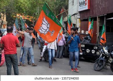 Bharatiya Janta Party or BJP activist waves BJP flag during Lok Sabha election campaign rally on April 01, 2019 in Calcutta, India.