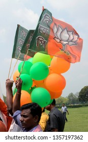Bharatiya Janta Party or BJP activist hold BJP flag and balloon during Lok Sabha election campaign rally on March 29, 2019 in Calcutta, India.