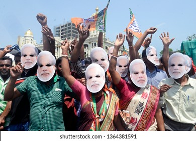 Bharatiya Janta Party or BJP activist wear Prime Minister Narendra Modi mask and shout slogan during a campaign rally ahead of Lok Sabha election 2019 on April 03, 2019 in Calcutta, India.