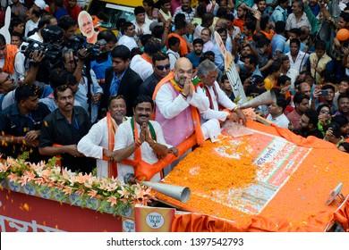 Bharatiya Janta Party or BJP president Amit Shah greets people during a road show to campaign for BJP Lok sabha candidates ahead of final phase of Lok Sabha polls on May 14, 2019 in Kolkata.