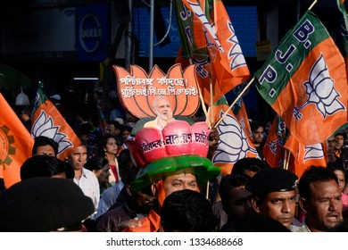 Bharatiya Janta Party or BJP supporter wears a lotus shape hat with Prime Minister Narendra Modi and participate a rally on January 30, 2019 in Calcutta, India.