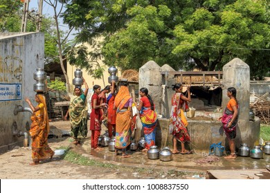 Bharuch,Gujarat,India,Asia,April,9,2011: Gujarati village women in traditional costume fetching  potable drinking water in steel pots on their head from village well ,Bharuch,Gujarat,India, Asia
