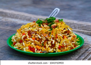 Bhelpuri is a savoury snack or chaat. It is made out of puffed rice, vegetables and a tangy tamarind sauce