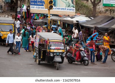 Bhilwara, India - April 26, 2016: crowded Nehru Road with typical Indian street life with vehicles and a lot of peoples
