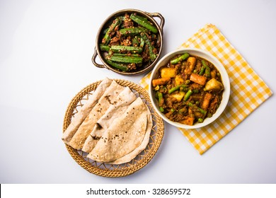Bhindi masala or ladies finger fry and Mixed veg in red hot curry served with indian roti / chapati or Indian Flat bread