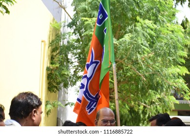 Bhopal 19 June Supporter caring BJP Flag While There MLA Starting Road construction on 19th June 2018 at Bhopal Pragati nagar