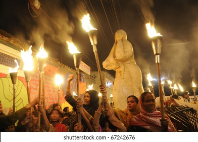 """BHOPAL- DECEMBER 2: Angry victims in front of the """"Bhopal Mother Statue""""  during the torch rally organized to mark the 26th year of Bhopal gas disaster, in Bhopal - India on December 2, 2010."""