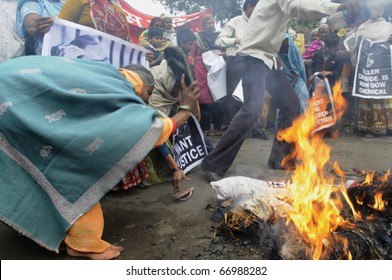 BHOPAL- DECEMBER 2: Angry and violent mob during the rally to mark the 26th year of the Bhopal Gas Disaster in Bhopal - India on December 2, 2010.