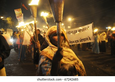 BHOPAL- DECEMBER 2: An old woman participate in the protest during the torch rally organized to mark the 26th year of Bhopal gas disaster, in Bhopal - India on December 2, 2010.