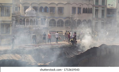BHOPAL, MADHYA PRADESH / INDIA - APRIL 25, 2020: fire burn down a wood store rescue team successfully cool down the fire in Itwara, Fish Market, Bhopal, Madhya Pradesh, INDIA