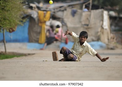 BHOPAL- NOVEMBER  28:  Sachin a 16 years old Bhopal gas victim who allegedly lost strength in his limbs  because of water contamination playing cricket in Bhopal - India on November 28, 2010.