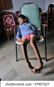 BHOPAL- NOVEMBER 30:9 years old Sitesh who is suffering from Spastic Cerebral Palsy and Spina bifida which restricts his movement and speech sitting in his room  in Bhopal -India on November 30, 2010.