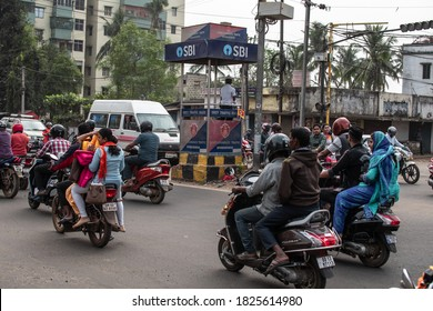 Bhubaneswar, India - February 4, 2020: Unidentified people travels by motorbikes and cars in traffic on February 4, 2020 in Bhubaneswar, India