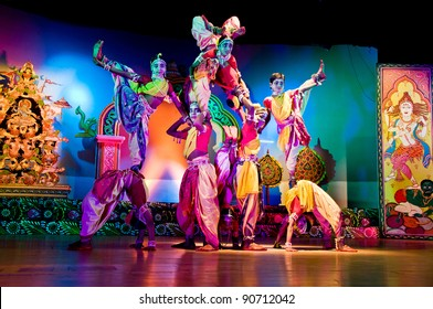 BHUBANESWAR, INDIA - NOVEMBER 24: An unidentified group of Male dancers wears traditional Ladies costume and performs Gotipua dance at Rabindra Mandap on November 24, 2011 in Bhubaneswar, India