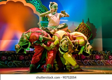 BHUBANESWAR, INDIA - NOVEMBER 24: An unidentified group of male dancers wears traditional ladies costumes and perform Gotipua dance at Rabindra Mandap on November 24, 2011 in Bhubaneswar, India