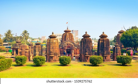 BHUBANESWAR, ODISHA / INDIA - JANUARY 20, 2019: Visitors studying beautyfull Mukteshvara Temple - 10th century hindu temple dedicated to Lord Shiva