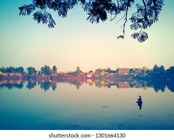 BHUBANESWAR / ORISSA, INDIA - JANUARY 20, 2019: Man fishing on Bindu Sagar lake at sunset