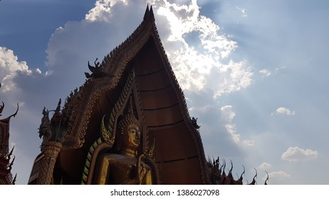Bhudda and the sky with sunshine
