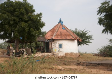 BHUJ, GUJARAT, INDIA, 12 OCTOBER 2015 : Traditionally decorated hut Bhunga at village, it's traditional Mud Hut. Thatched roof, Decorative hand painted motifs.
