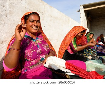 BHUJ, INDIA - JANUARY 13: Women sewing ethnic dresses living on the desert in the Gujarat state in India, Bhuj in January 13, 2015