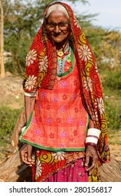 BHUJ, RAN OF KUCH, INDIA - JANUARY 13: The tribal woman in the traditional dress he is going through deserts in of Ran of Kuch in the Gujarat state in India, Ran of Kuch in January 13, 2015