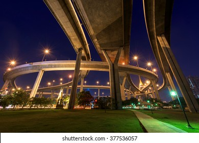 "Bhumibol Bridge above park at dawn in Bangkok, Thailand. Foreign text on the bridge is the bridge name ""Bhumibol 1"""