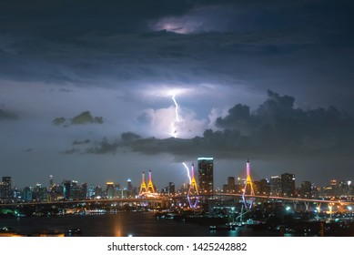 Bhumibol Bridge before heavy rain, with lightning coming down in the middle of the bridge