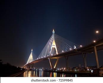 Bhumibol Bridge also casually call as Industrial Ring Road Bridge illuminate with spotlight at night scene, Samut Prakarn,Thailand