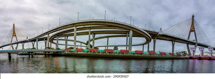 Bhumibol Bridge with cloudy on a rainy overcast . The Bridge across Chao Phraya River in Bangkok, Thailand.