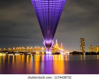The Bhumibol Bridge (Industrial Ring Road Bridge) (Bangkok, Thailand) Beautiful view at twilight, Bangkok Expressway, expressway and motorway at night Aerial view from under the bridge