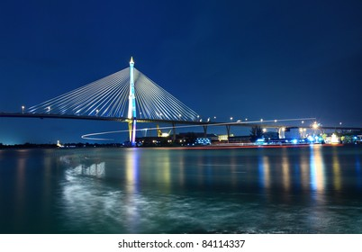 Bhumibol Bridge at night in Bangkok, Thailand.