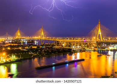 """Bhumibol Bridge is one of the most beautiful bridges in Thailand and area view for Bangkok with thunderclap. Name of bridge comes from the name of The king of Thailand. Translate text""""Bhumibol Bridge"""""""