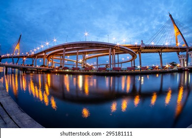 Bhumibol Bridge at sunset with fisheye view. It is also known as the Industrial Ring Road Bridge, in Thailand. The bridge crosses the Chao Phraya River twice.