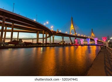 Bhumibol Bridge in Thailand or the Industrial Ring Road Bridge in evening scene of sunset and twilight scenery mood