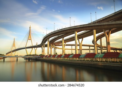 Bhumibol Bridge in Thailand, also known as the Industrial Ring Road Bridge, in Thailand. The bridge crosses the Chao Phraya River twice in the blue sky