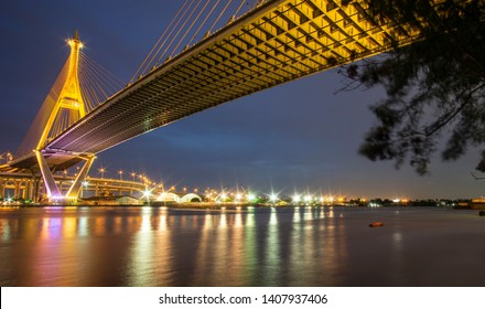 """Bhumibol Bridge turn on the lights in many colors at night. Thai translation: the name of the bridge over the pillar """"Bhumibol Bridge 1"""""""