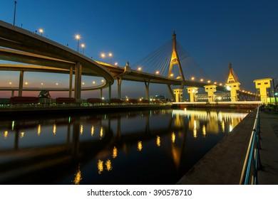 "Bhumibol suspension Bridge at dusk in Bangkok, Thailand. Foreign text on the bridge is the bridge name ""Bhumibol 1"""